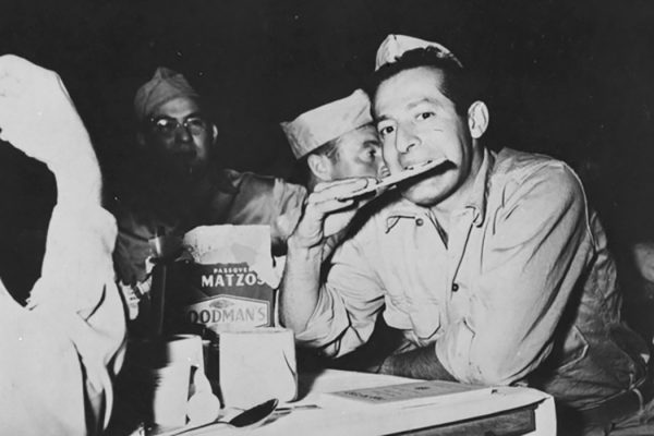 Soldier eating matzo, 1940s