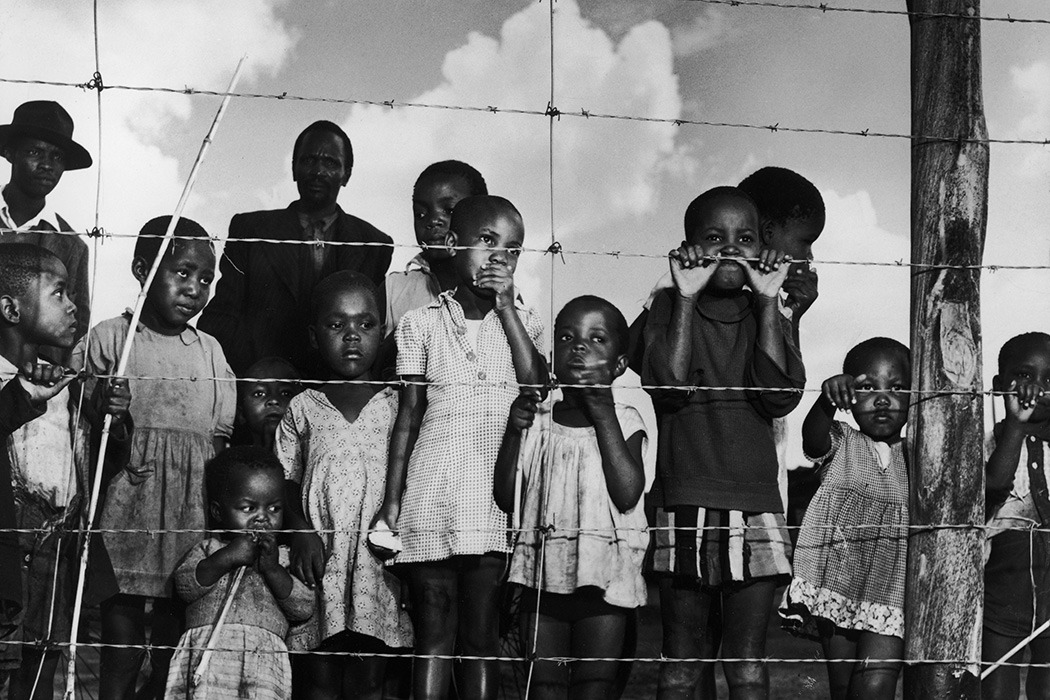 Children behind barbed wire