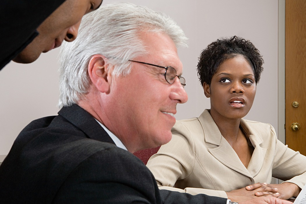 Woman looking at men whispering