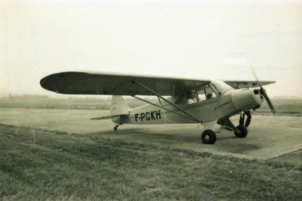 Piper Cub plane farmers