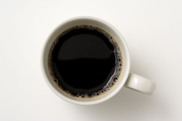 Isolated shot of a cup of coffee on white background