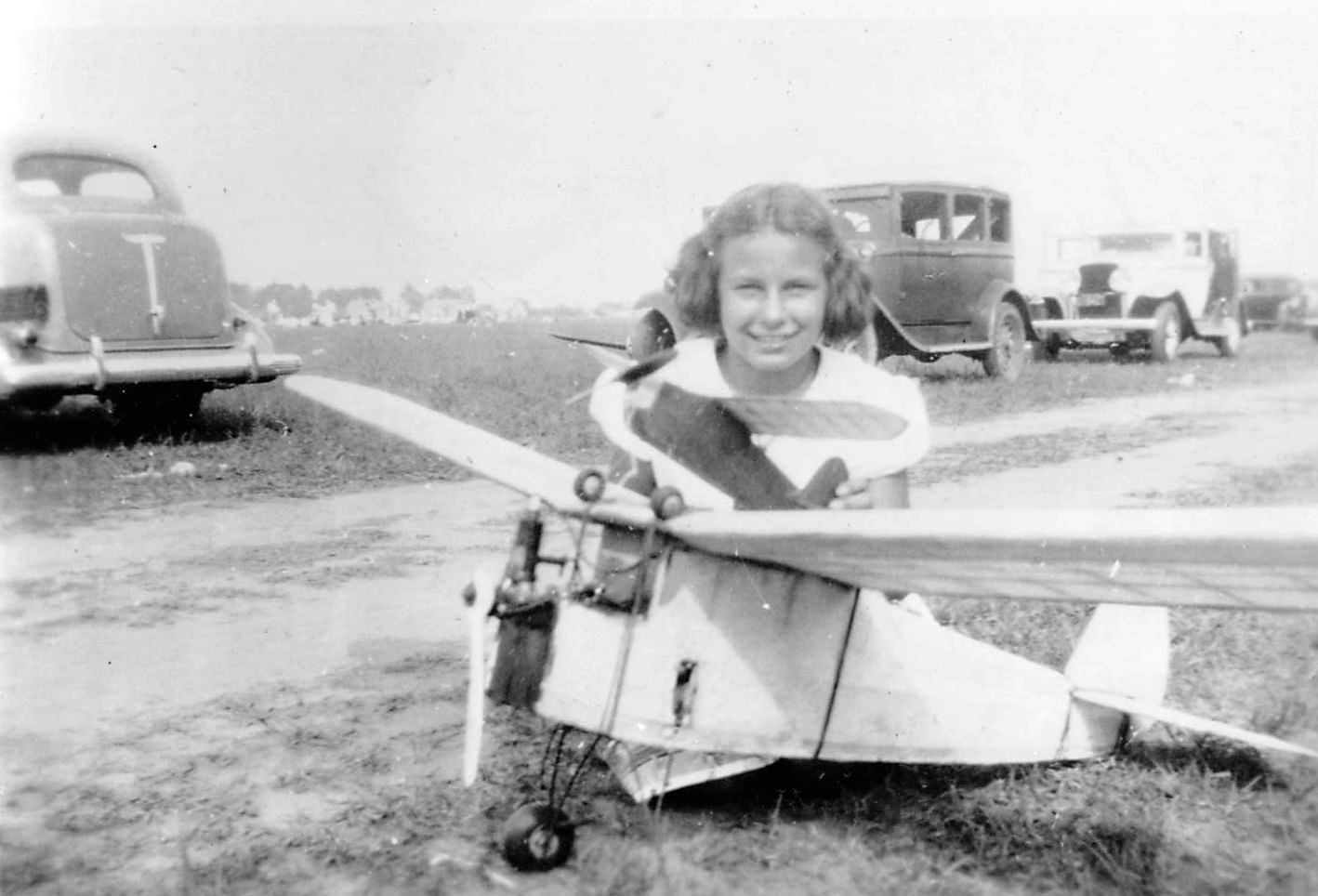 Girl with model plane