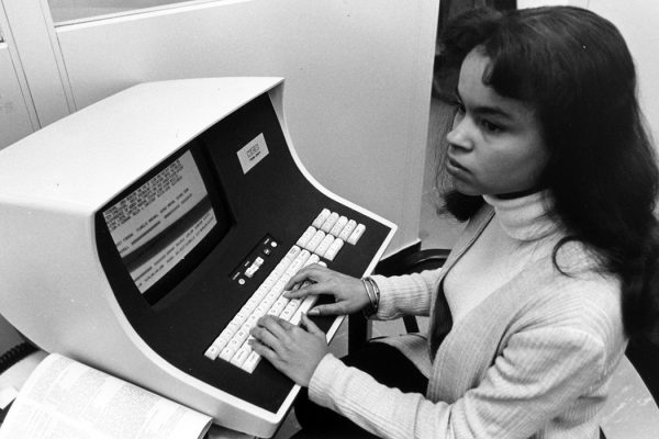 Woman using computer in the 1970s