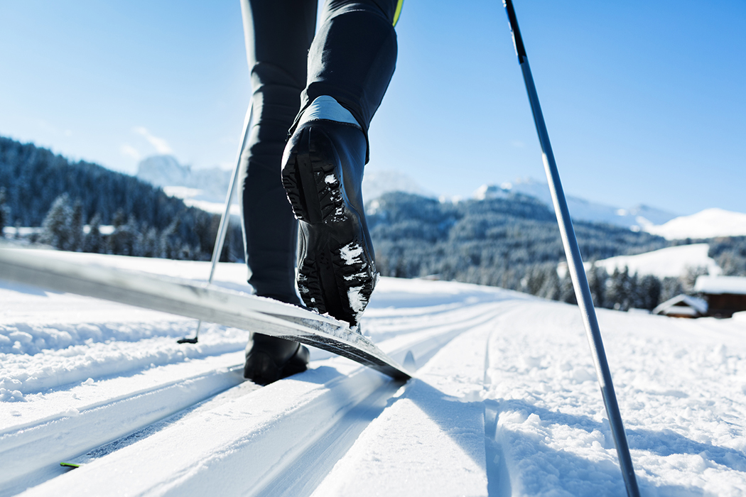 Close-up of a mans legs doing cross-country skiing in the Alps.