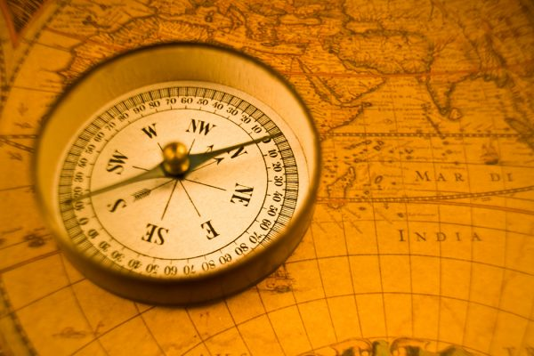 Compass On Antique Map magnetic poles