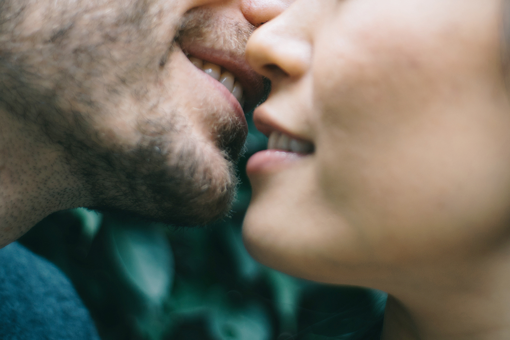 Cropped Image Of Man And Woman Kissing