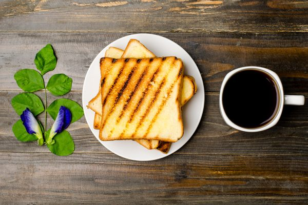Toast and coffee on wooden background,breakfast or meal