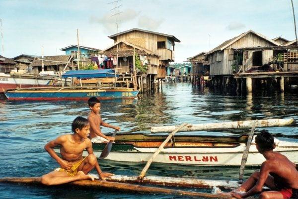 Bajau boys on boat