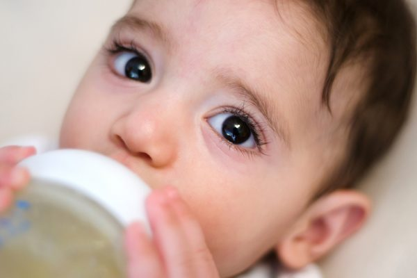 Baby Drinking from Bottle, close-up