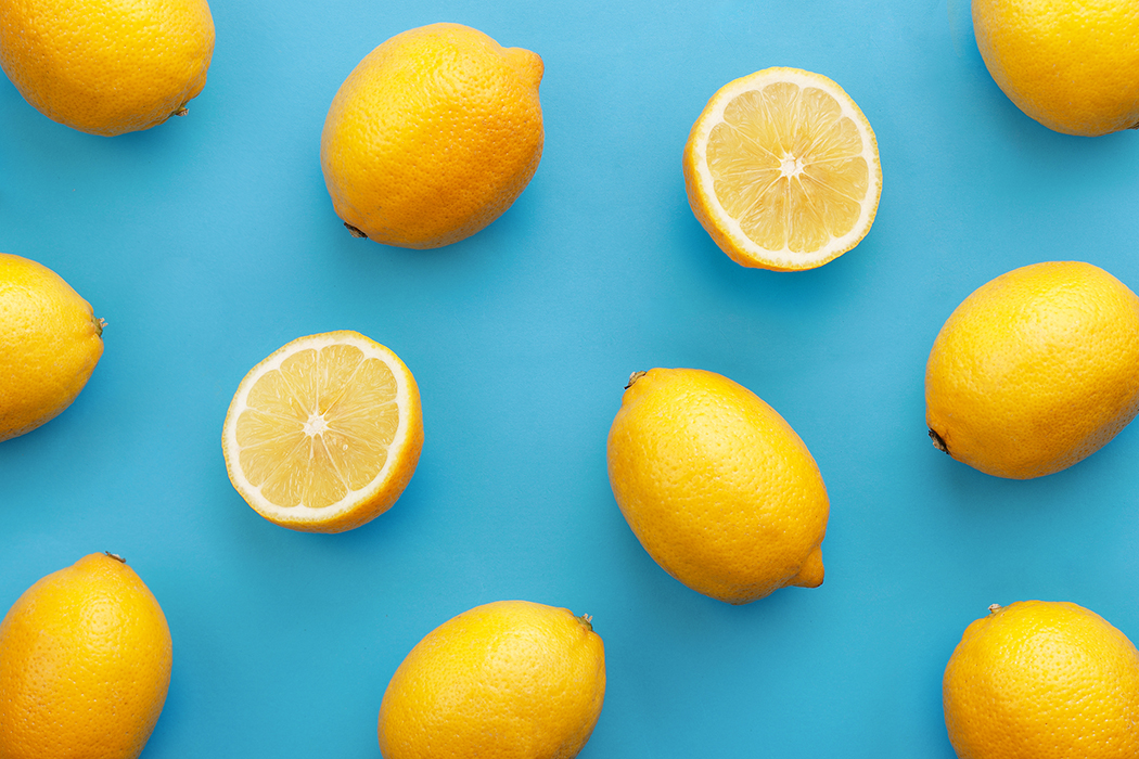 Close-Up Of Lemons On Blue Background