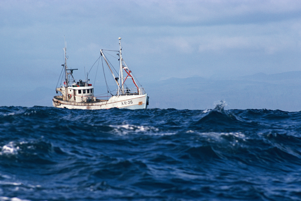 Fishing boat in high seas