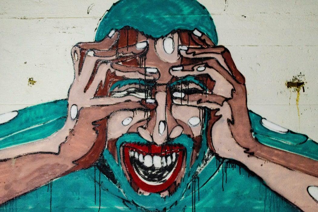 A person in distress, from graffiti in Finland