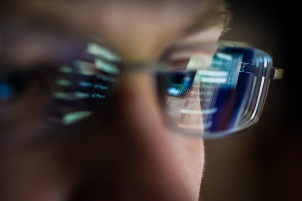 A computer screen reflected in glasses