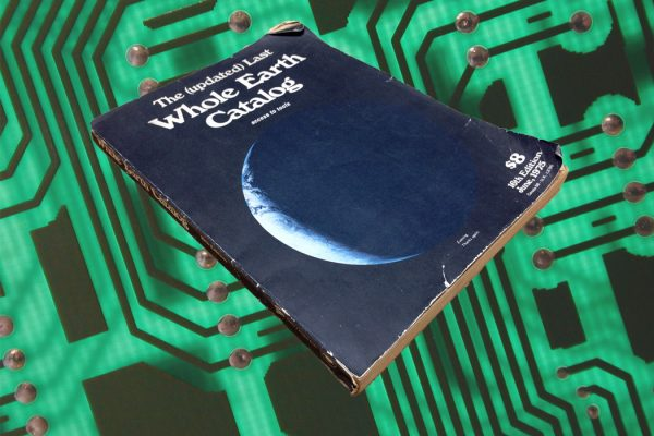A copy of The Whole Earth Catalog hovering over a circuit board