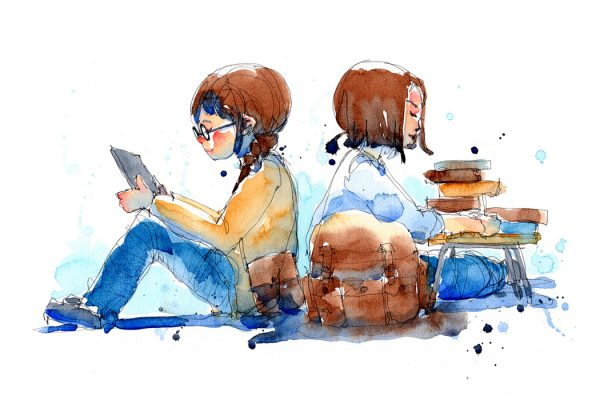 Two young people reading together.