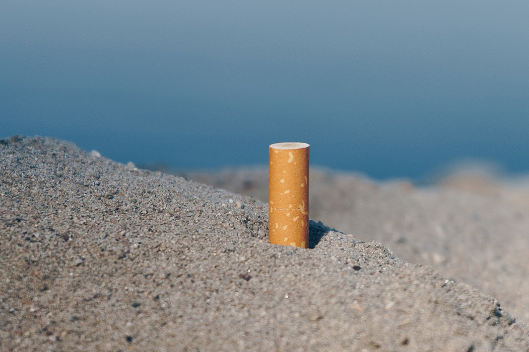 A cigarette butt in the sand.