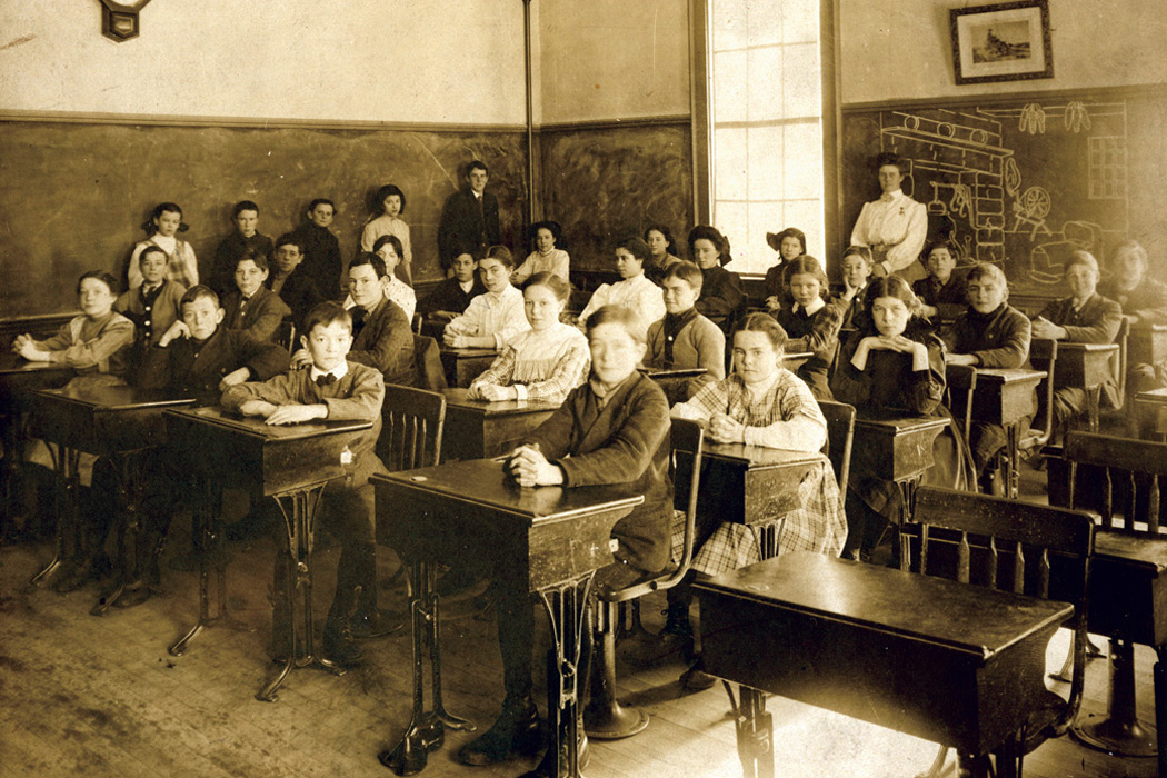 A classroom of white students in the 19th century