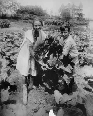 School children holding one of the large heads of cabbage raised in the War garden of Public School 88, Borough of Queens, New York City
