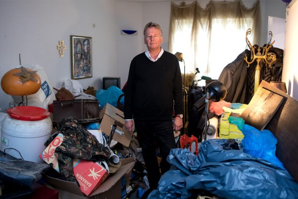 Someone standing in the room of a hoarder