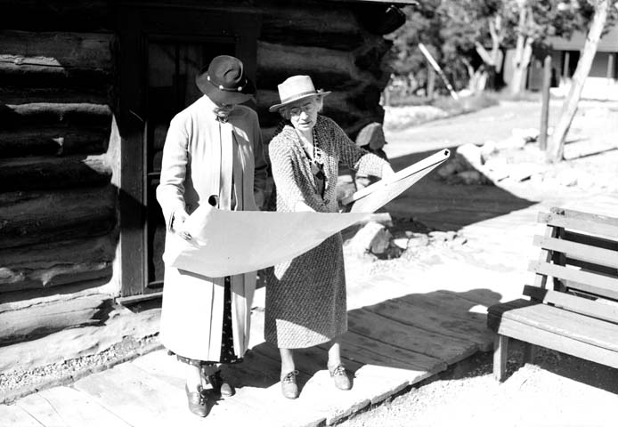 Mary colter (R) Showing blueprint to mrs ickes (Wife of secretary of interior) Circa 1935
