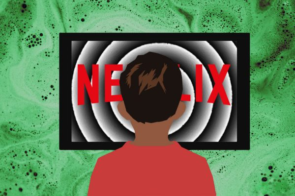 A child in front of an ominous Netflix television screen.