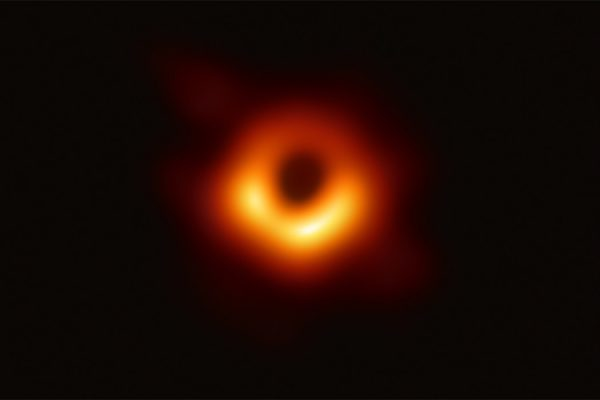 First image of a black hole by the Event Horizon Telescope. The object M87* is located at the heart of distant galaxy Messier 87.