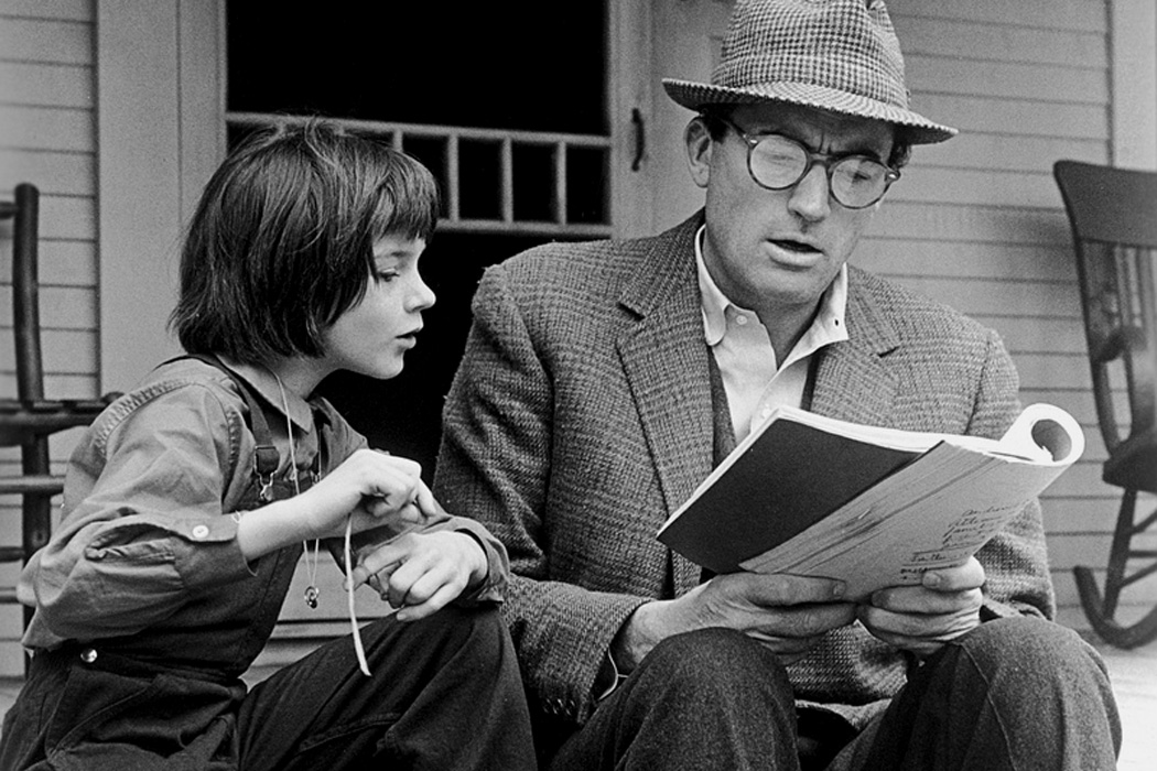 Gregory Peck and Mary Badham review the script for the film, 'To Kill a Mockingbird' directed by Robert Mulligan.