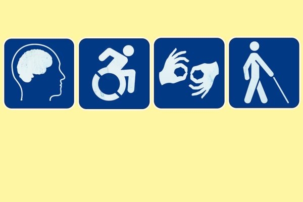A series of four blue pictograms in front of a light yellow background. Three pictograms are disability access symbols, for wheelchair accessibility, sign language interpretation, and low vision access. The fourth pictogram is of a brain, and is meant to symbolize cognitive impairment accommodations.