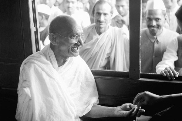 Mahatma Gandhi receiving a donation in a train compartment, 1940
