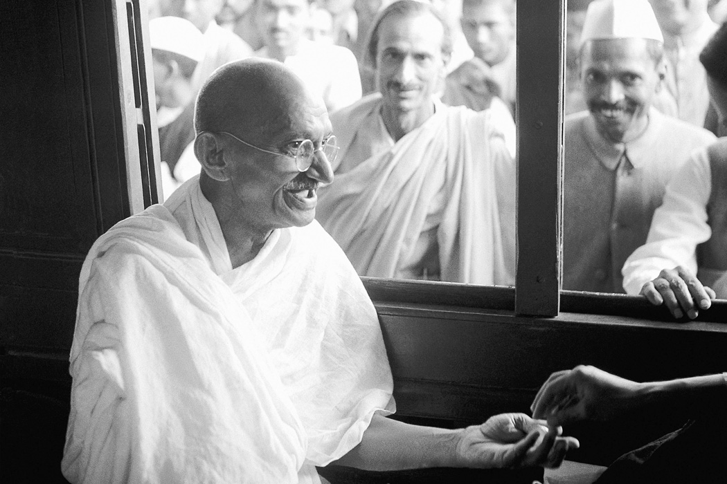 Mahatma Gandhi receiving a donation in a train compartment, 1940