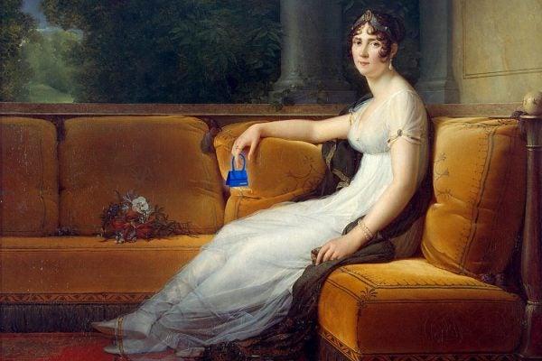 Empress Joséphine holding a Jacquemus Mini Le Chiquito handbag