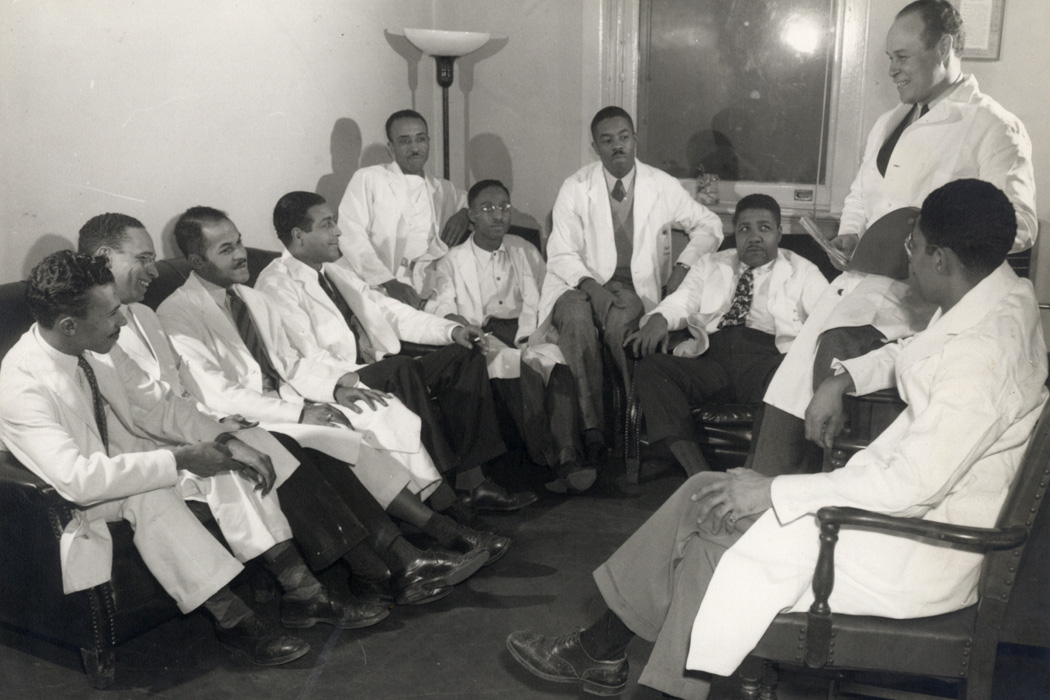 Charles Drew sitting with medical residents at Freedmen's Hospital