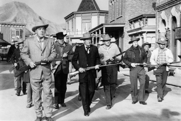 Lon Chaney and Richard Arlen lead vigilante committee in a scene from the film 'The Town Tamer', 1965.