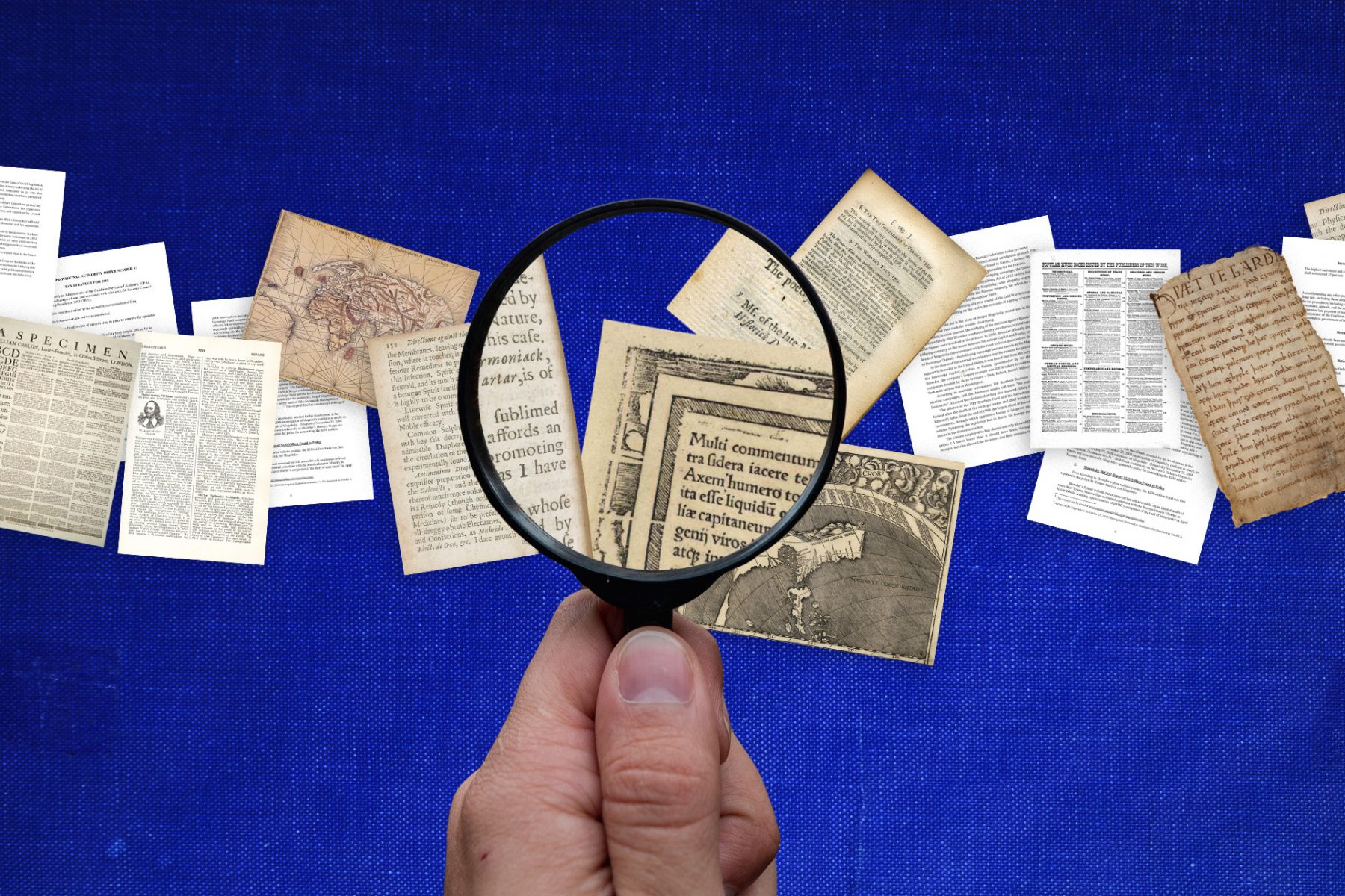 A hand holding a magnifying glass looking at pages with different fonts