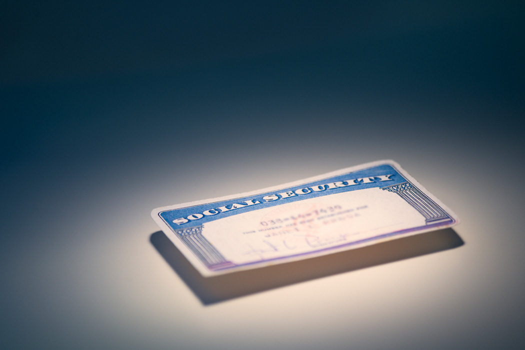 A social security card on a plain surface.