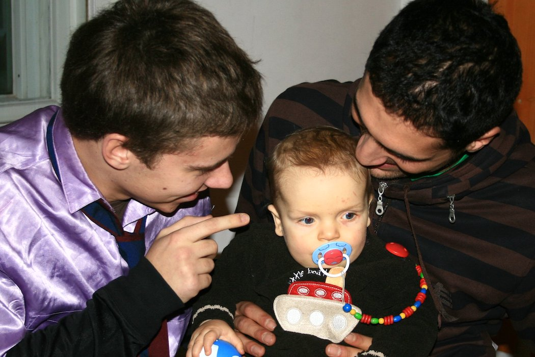 Two men and a baby