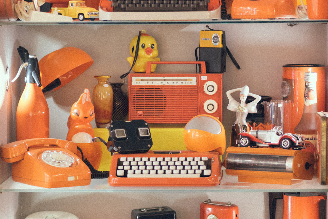 A variety of vintage orange plastic items