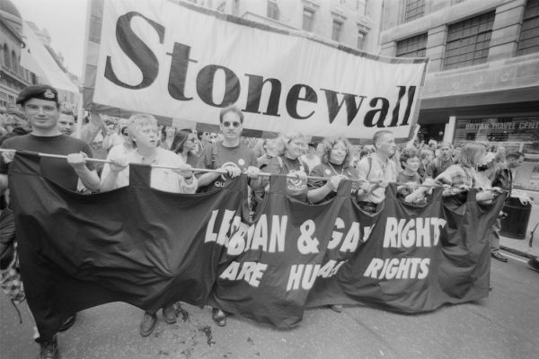 Protestors from lesbian, gay and bisexual rights charity Stonewall, carrying a banner reading 'Lesbian & Gay Rights are Human Rights' during the Gay Pride parade in London, England, United Kingdom, 6 July 1996