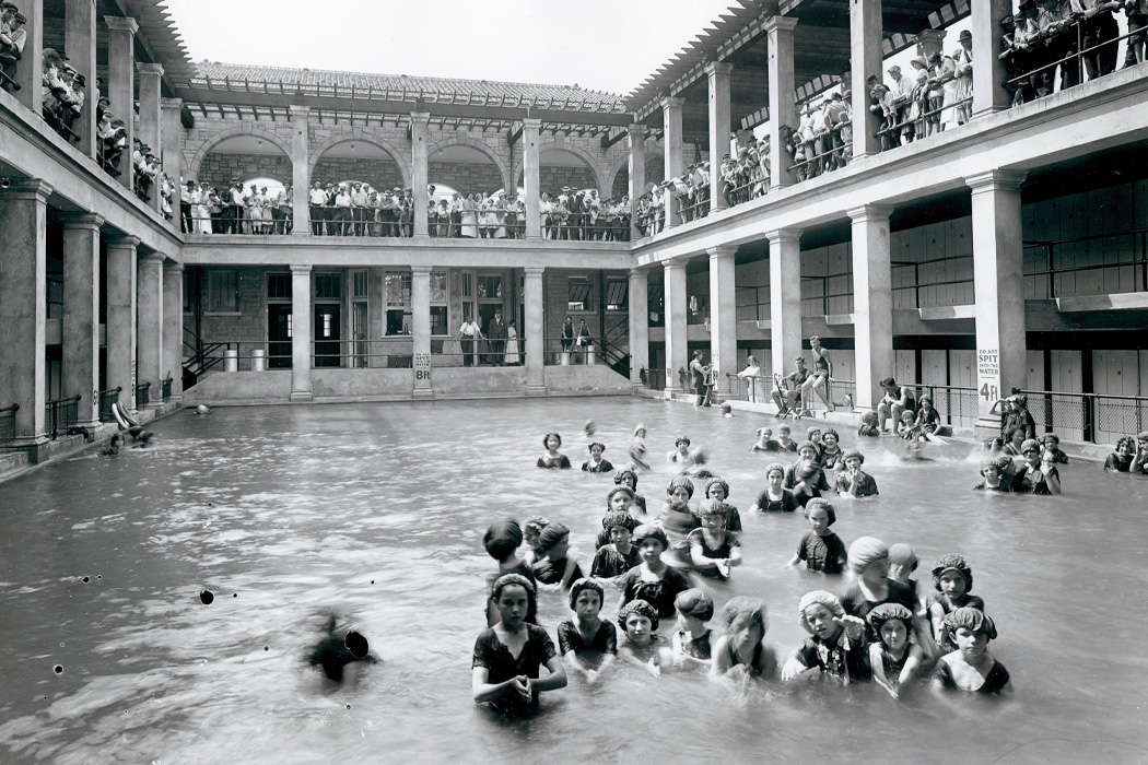 Girls in a swimming class entertain an audience of neighborhood residents at Mullanphy Pool in St. Louis, MO