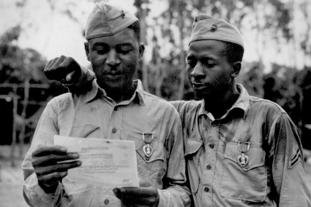The first black marines decorated by the famed 2nd Marine Dvision somewhere in the Pacific. (Left to right) Staff Sgt Timerlate Kirven and Cpl. Samuel J. Love, Sr., received Purple Hearts for wounds received in the Battle of Saipan.