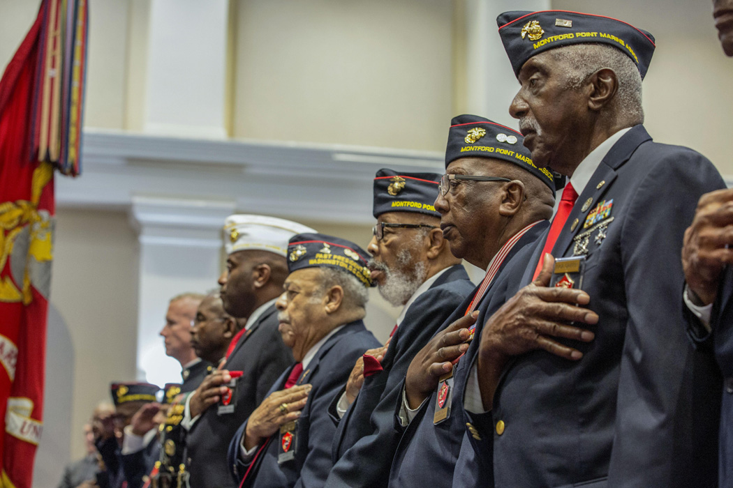 Montford Point Marines stand for the national anthem during an evening parade at Marine Barracks Washington in Washington, D.C., June 16, 2017.