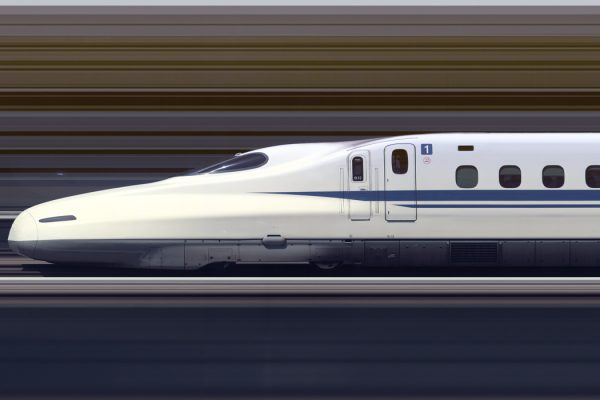 The Shinkansen N700A Series Set G13 high speed train travelling at approximately 300 km/h through Himeji Station, Japan
