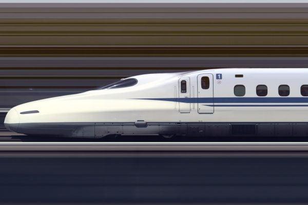 The Shinkansen N700A Series Set G13 high speed train travelling at approximately 300 km/h through Himeji Station, Japan