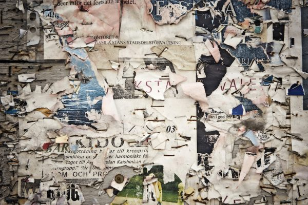 View of torn poster on wall