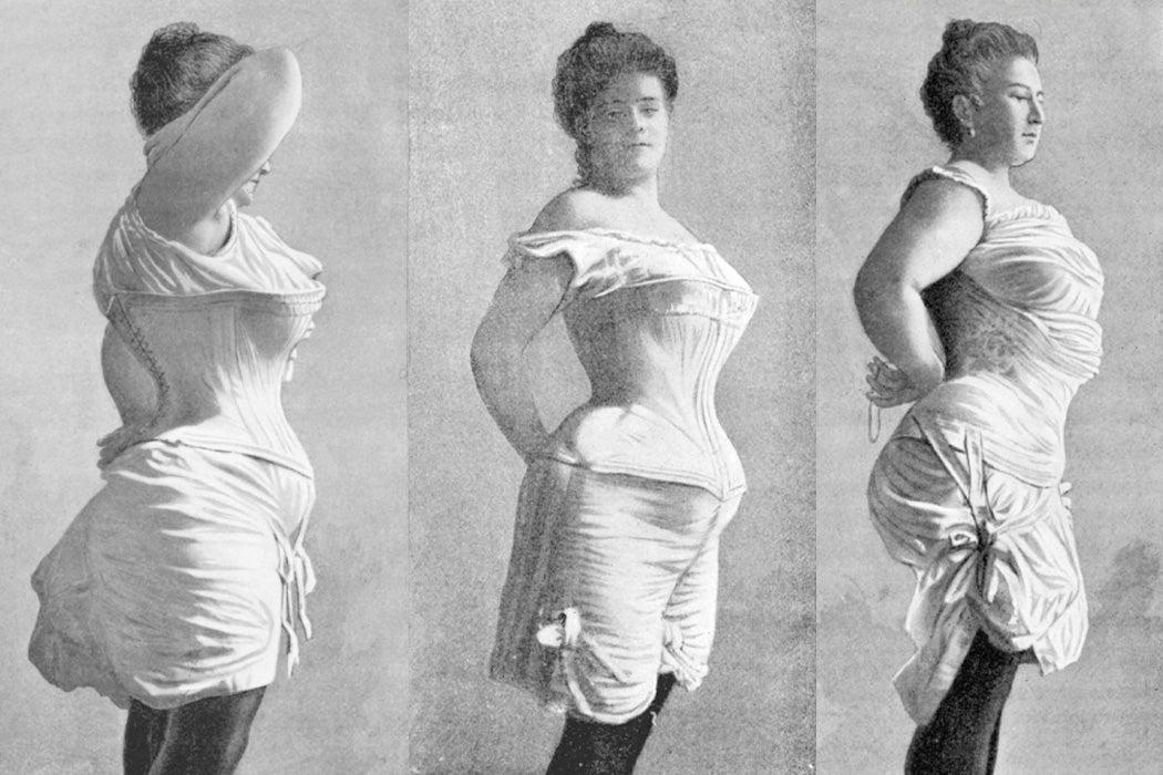 Three women wearing corsets