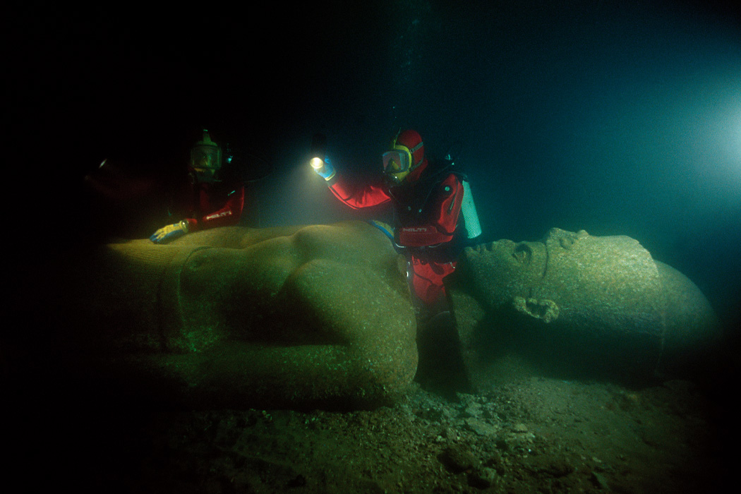 archaeologists Franck Goddio and his team inspect the colossal red granite statue of a pharaoh of over 5 metres height, weighing 5.5 tons, and shattered into 5 fragments. It was found close to the great temple of sunken Heracleion.