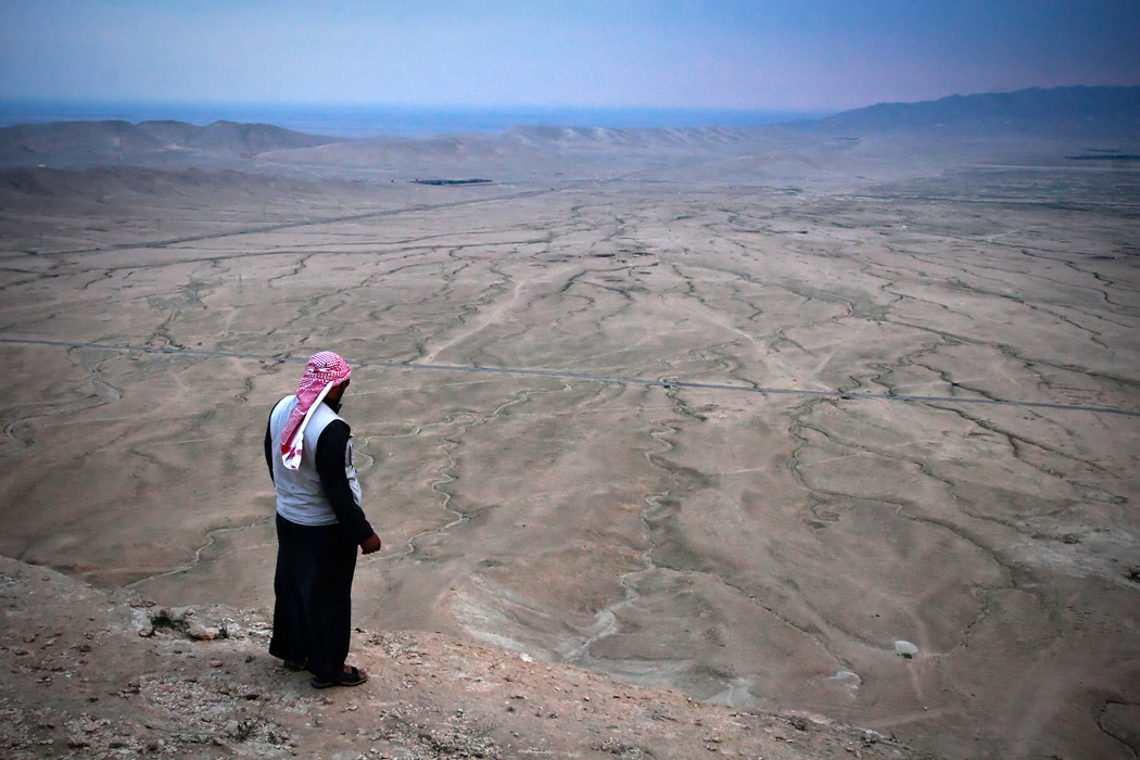 A man looking at land affected by drought