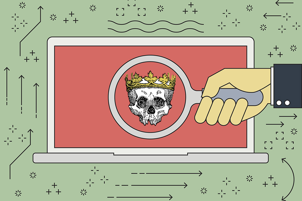 A laptop with a skull wearing a crown on its screen