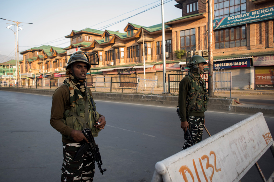 Indian Paramilitary troopers stand guard in the city center Srinagar, Kashmir, India