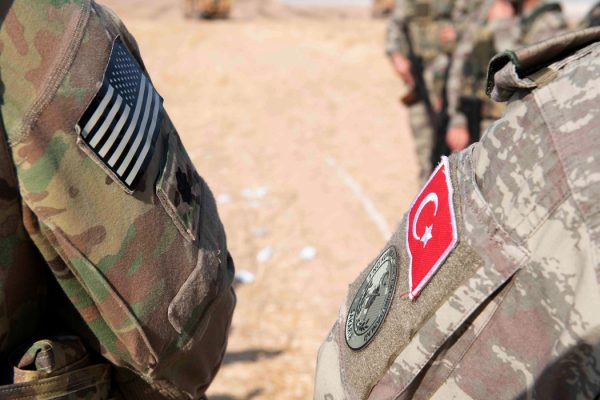 An American and Turkish soldier in Syria